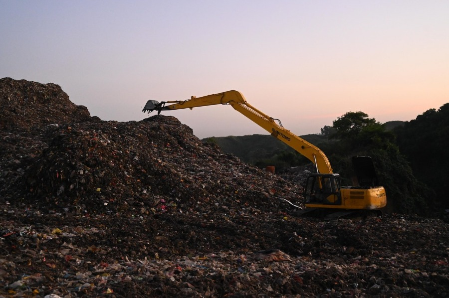 Image of a landfill. One safe ways of how to dispose of pressure treated wood