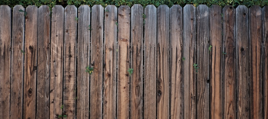 Image of wood fence but which is better, cedar vs redwood fence?