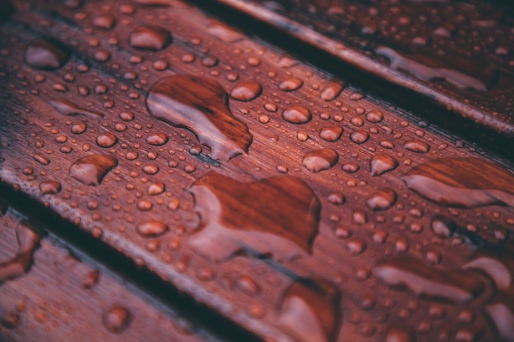Image of rain drops on a deck but, How Long Does Deck Stain Need to Dry Before it Rains?