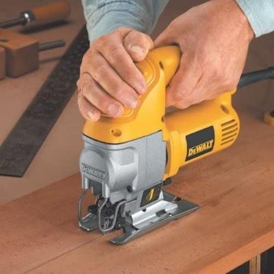 Woodworker using Dewalt, the best jigsaw for woodworking