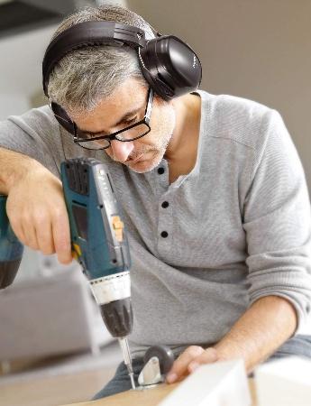 Image of a woodworker wearing hearing protectors for woodworking
