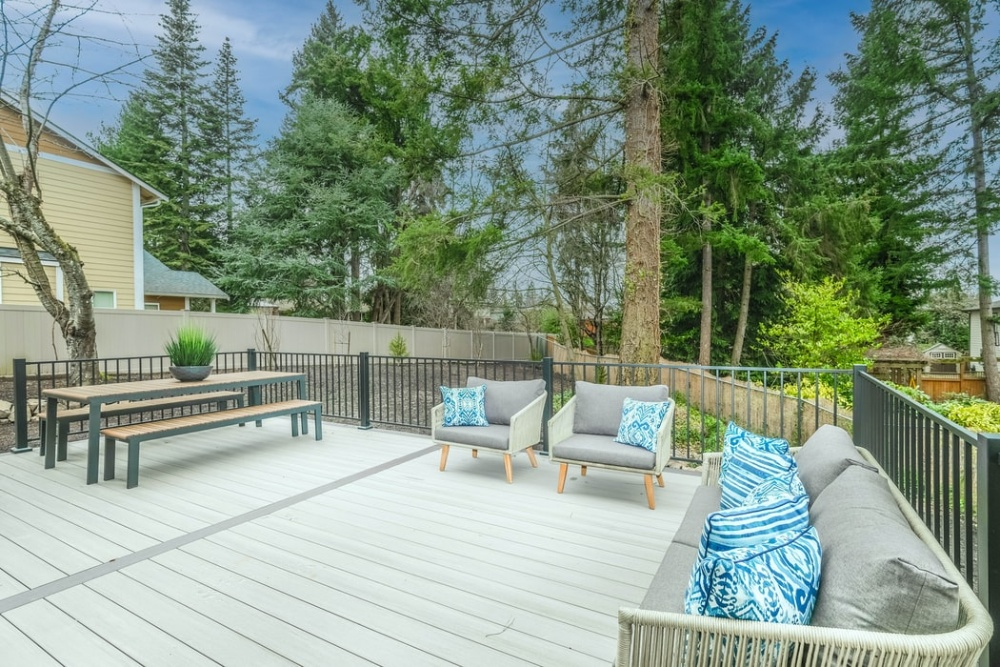 Image of an outdoor deck. So, Will an Outdoor Rug Damage a Wood Deck?