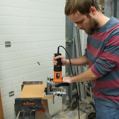 woodworker using triton, the best biscuit jointer for woodworking