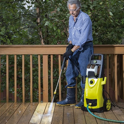 Deck owner cleaning a deck using the Best Pressure Washer for Wood Deck