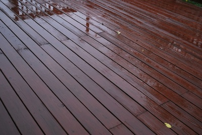 Image of stained wood deck after rain