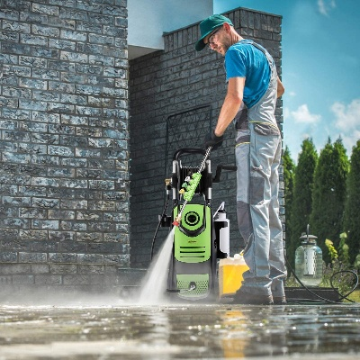 A pressure washer in use but How Long After Pressure Washing to Stain Deck?