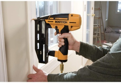Image of finish nailer in use but What Is the Difference Between a Brad Nailer and a Finish Nailer?