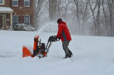 Image of a deck owner using the Best Snow Blower for Wood Deck