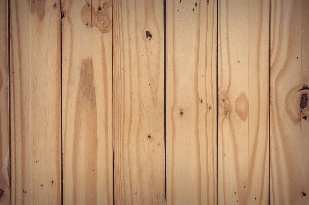 Image of treated wood. But which one in the Kiln Dried Vs Pressure Treated Lumber discussion